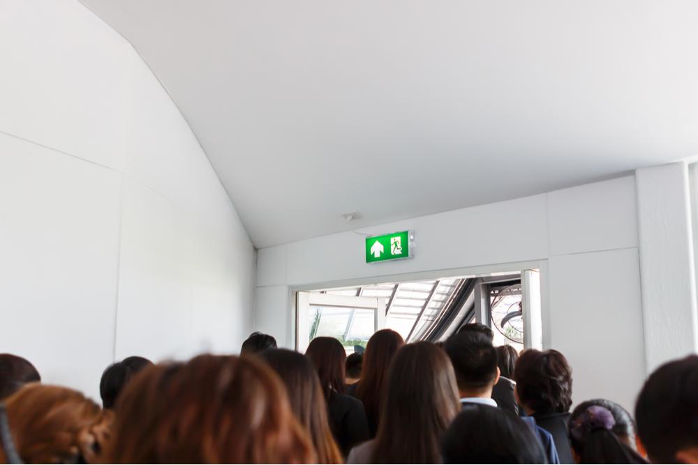 people walking towards exit