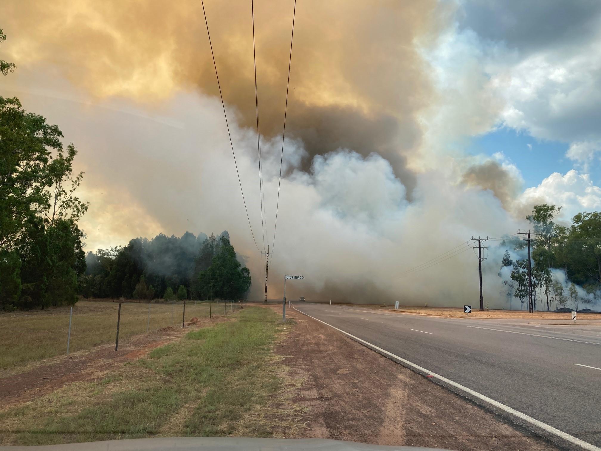 Bush fire crossing road Howard Springs